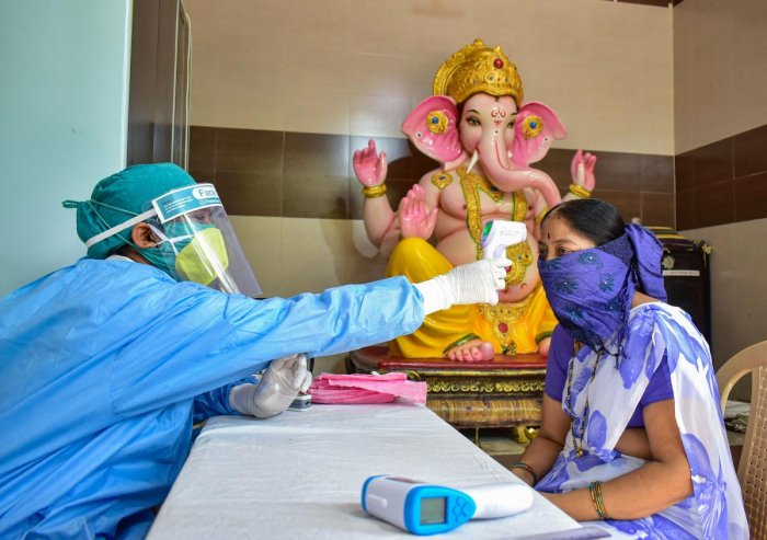 Medics conduct screening of residents at a camp, in wake of the coronavirus pandemic, during the ongoing nationwide lockdown, at a containment zone, in Solapur, Wednesday, May 27, 2020. (PTI Photo)