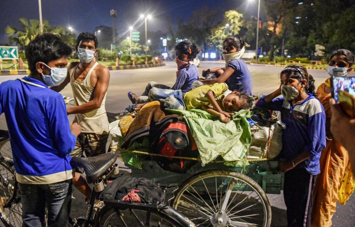 New Delhi: Migrant worker Ganga and his family members, traveling from Gurugram, walk along a road towards their native place Pilibhit in Uttar Pardesh during ongoing COVID-19 lockdown, in New Delhi, Monday, June 1, 2020. (PTI Photo/Manvender Vashist)(PTI