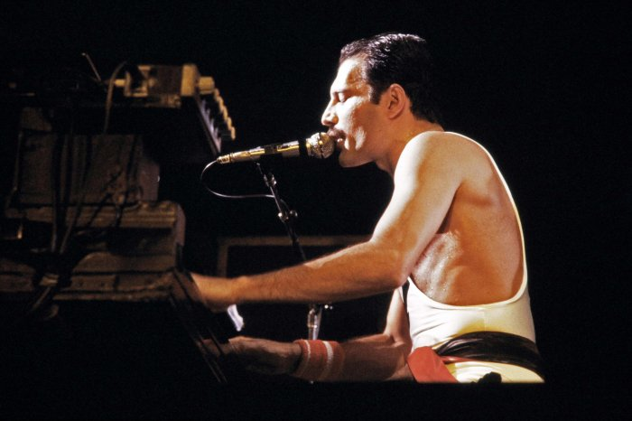 """In this file photo taken on September 18, 1984 rock star Freddie Mercury, lead singer of the rock group """"Queen"""", performs during a concert at the Palais Omnisports de Paris Bercy (POPB). - The Freddie Mercury biopic """"Bohemian Rhapsody"""", reflects the enduring appeal of Queen and their legendary frontman 27 years on from his death. In the pipeline for eight years, the film could deliver another smash hit, with Egyptian-American actor Rami Malek winning rave reviews for his performance as Mercury. AFP Photo"""