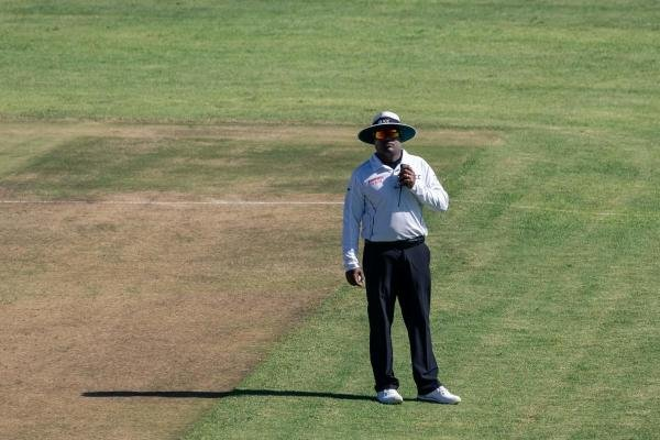 In this file photo taken on January 21, 2020 umpire Nitin Menon awaits Langton Rusere, the third umpire's decision on the dismissal of Sri Lanka's Dinesh Chandimal during the third day of the first Test cricket match between Zimbabwe and Sri Lanka at the Harare Sports Club in Harare. Credit: AFP Photo