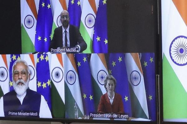 European Council President Charles Michel, top screen, and European Commission President Ursula von der Leyen, screen right, speak with India's Prime Minister Shri Narenda Modi, screen left, during an EU-India videoconference summit. Credit: AP
