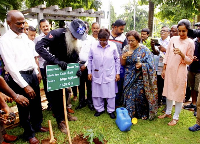 Founder of Isha Foundation Sadhguru Jaggi Vasudev plants a sapling on the precincts of Raj Nivas (office of Lt Governor) during his visit in a bike rally spreading 'Cauvery Calling Mission', in Puducherry