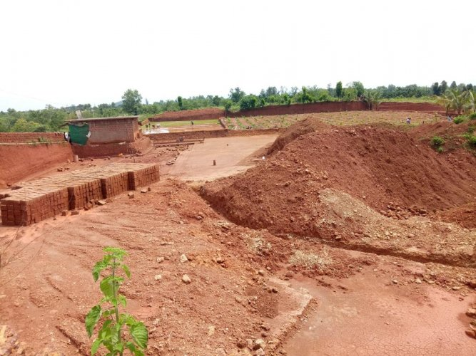 The quarry land being levelled to carrying out farming activities at Ujirbettu.