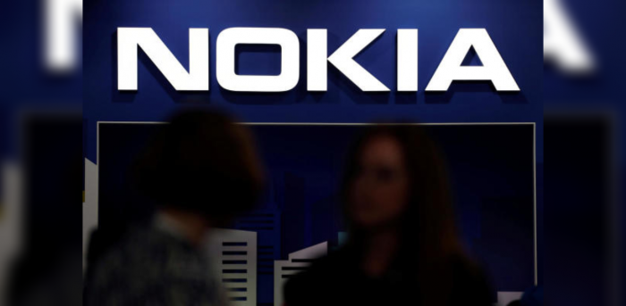 Visitors gather outside the Nokia booth at the Mobile World Congress in Barcelona. Credit: Reuters Photo