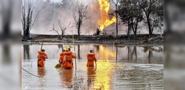 National Disaster Response Team (NDRF) personnel carry out search and rescue operations after two firemen of Oil India Limited went missing since an oil well at the company's Baghjan oilfield exploded, in Assam's Tinsukia district, Wednesday, June 10, 2020. Credit: PTI Photo