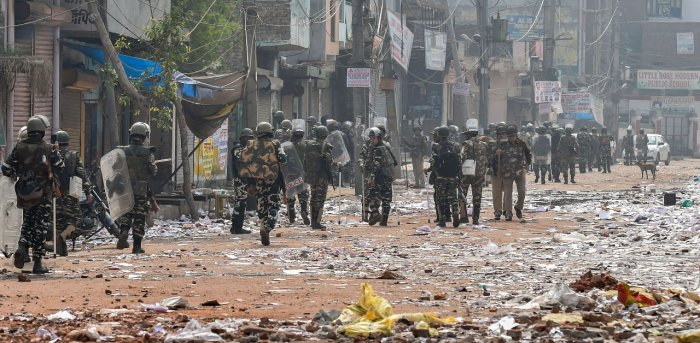 Security personnel conduct patrolling as they walk past Bhagirathi Vihar area of the riot-affected north east Delhi. Credit: PTI File Photo