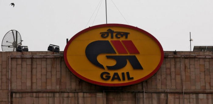 Birds fly past the logo of India's state-owned natural gas utility GAIL (India) Ltd installed on its corporate office building in New Delhi. Credit: Reuters