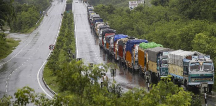Truck stranded at J&K National Highway as it remains closed due to multiple landslides triggered by rains, in Jammu. Credit: PTI Photo