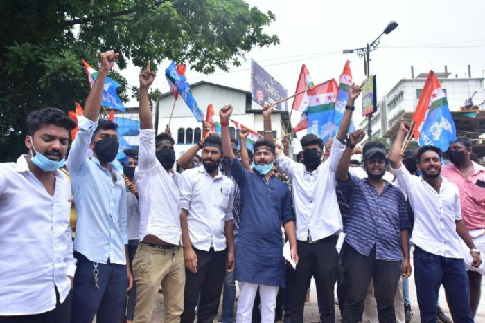 NSUI members stage a protest in front of University College in Mangaluru on Monday.