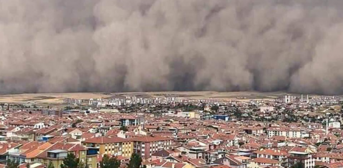 A handout TV grab made available by the Demiroren News Agency (DHA) on September 12, 2020, shows a freak sandstorm sweeping over Polatli, in Ankara, on September 12, 2020. Credit: AFP