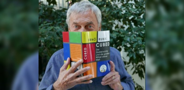 Erno Rubik with his book 'Cubed'. Credit: Twitter/@Rubiks_Official