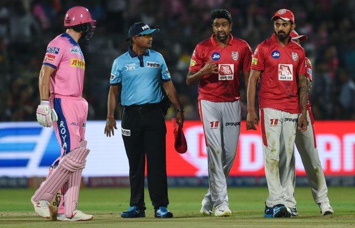 Rajasthan Royals' Jos Buttler (left) exchanges words with Kings XI Punjab's Ravichandran Ashwin during their IPL match in Jaipur on Monday. AFP