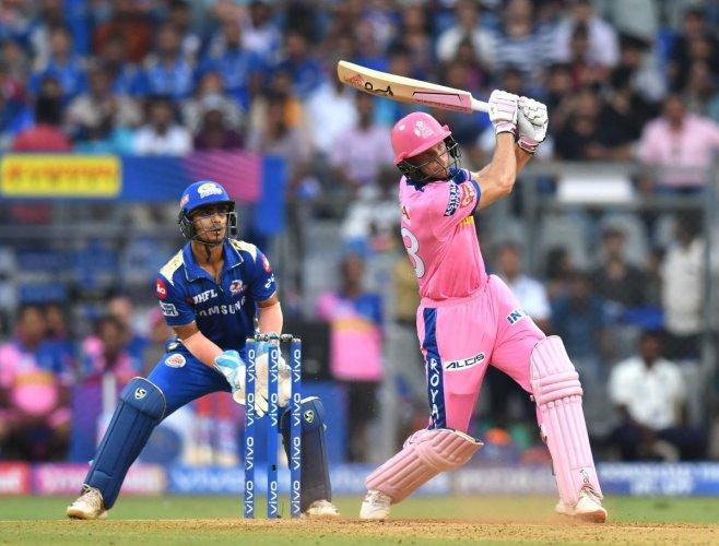 Rajasthan Royals batsman Jos Buttler (R) plays a shot during the 2019 Indian Premier League (IPL) Twenty20 cricket match between Mumbai Indians and Rajasthan Royals at the Wankhede Stadium in Mumbai. AFP photo