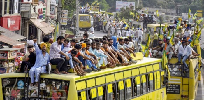 Members of various farmers' organizations on their way to stage a protest against the central government over agriculture related ordinances, in Patiala. Credit: PTI