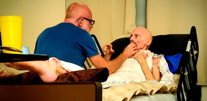 Timothy Ray Brown in home hospice with his partner, Tim Hoeffgen(L). Credit: AFP Photo
