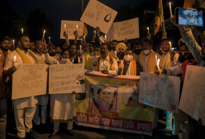 Activists of the Bharti Valmiki Aadi Dharam Samaj (BVADS) shout slogans as they participate in a candle march during a protest following accusations of Indian Police forcibly cremating the body of a 19-year-old woman victim, who was allegedly gang-raped by four men in Bool Garhi village of Uttar Pradesh state, in Amritsar on October 1, 2020. - Indian police were accused on September 30 of forcibly cremating the body of a 19-year-old alleged gang-rape victim as anger grew over the latest horrific sexual assa