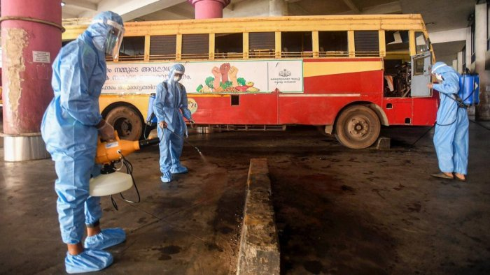 Health workers sanitise KSRTC Bus Stand, during Unlock 5, amid the coronavirus pandemic, in Kozhikode. Credit: PTI.