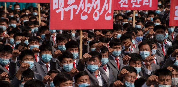 Participants wearing face masks gather during a rally marking the start of an '80-day Campaign' in support of the upcoming 8th Congress of the Workers' Party of Korea (WPK) to be held in January 2021, at Kim Il Sung Square in Pyongyang. Credit: AFP