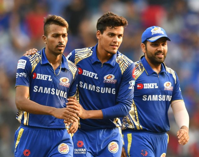 Rahul Chahar (centre) says the stint with Mumbai Indians in this year's IPL boosted his confidence. AFP