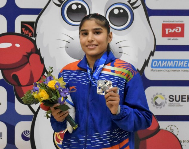 Manju Rani poses with with her silver medal (48 kg category) at the World Boxing Championships in Russia. PTI