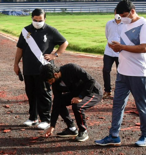 Youth Empowerment and Sports Minister C T Ravi inspects the track work at the Sree Kanteerava Stadium as Karnataka Olympic Association President K Govindraj (left) looks on. The minister visited the stadium to take part in the symbolic Olympic Run on Tuesday. DH Photo/ B H Shivakumar