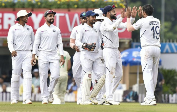 Indian bowler Umesh Yadav with captain Virat Kohli and other teammates celebrates the dismissal of South African batsman George Linde during day 3 of the 3rd cricket test match at JSCA Stadium in Ranchi, Monday, Oct. 21, 2019. (PTI Photo/Ashok Bhaumik)