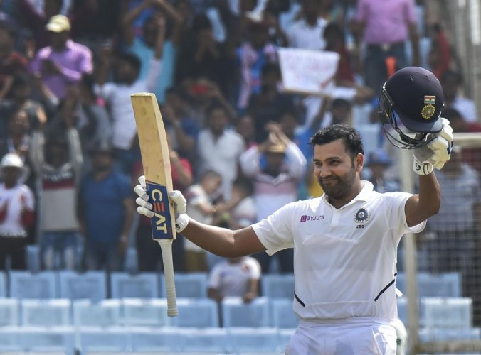 India's Rohit Sharma celebrates his double century during 2nd day of the 3rd cricket test match against South Africa at JSCA Stadium in Ranchi, Sunday, Oct. 20, 2019. (PTI Photo/Ashok Bhaumik)