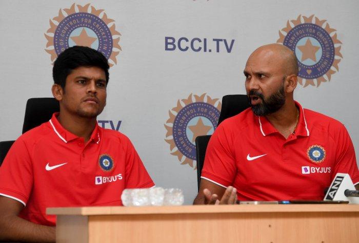 Batsman Priyam Garg (left) and under-19 head coach Paras Mhambrey.