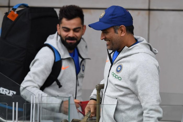 India's M S Dhoni (right) and captain Virat Kohli look relaxed as they arrive for a training session at Old Trafford on Saturday. AFP