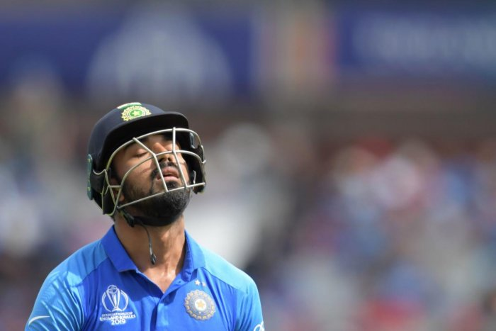 India's K.L. Rahul leaves the field after losing his wicket for 1 run during the 2019 Cricket World Cup first semi-final in Manchester, northwest England, on July 10, 2019. (Photo by/ AFP)