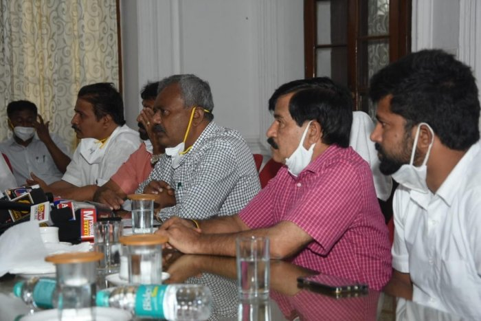 Cooperation Minister S T Somashekar, during a media conference in Mysuru on Tuesday. MUDA Chairman H V Rajeev, MLAs L Nagendra and S A Ramadass and MP Pratap Simha are seen. DH PHOTO
