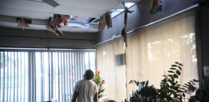 Tom Nguyn surveys the damage to his nail salon after Hurricane Zeta in Chalmette, Louisiana. Credit: AFP