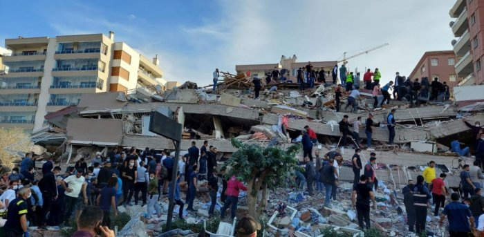 Locals and officials search for survivors at a collapsed building after a strong earthquake struck the Aegean Sea on Friday and was felt in both Greece and Turkey, where some buildings collapsed in the coastal province of Izmir, Turkey. Credit: Reuters