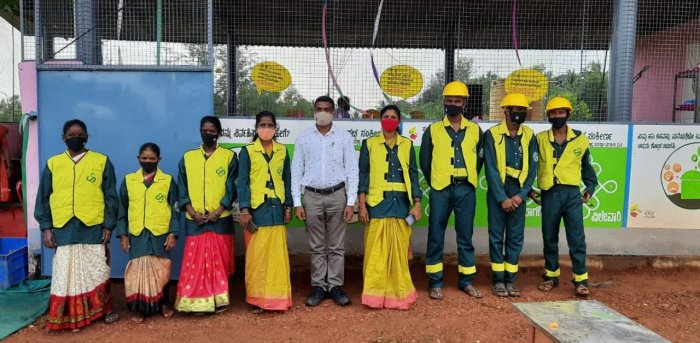 The staff of the waste management unit have uniforms as a part of the branding of the unit at Maravanthe. Credit: DH.