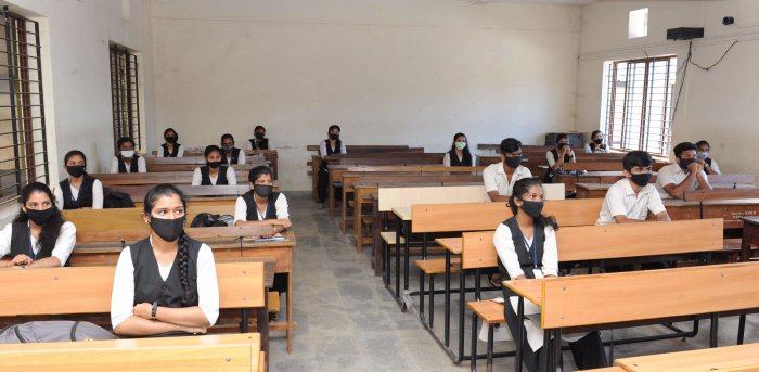 Students sitting by maintaining social distance inside a classroom in Mangaluru. Credit: DH Photo