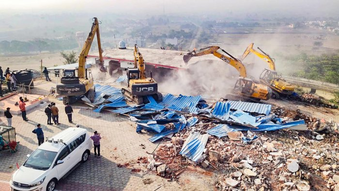 Authorities demolish an illegal construction of self-styled godman Computer Baba aka Namdev Das Tyagi, in Indore. Credit: PTI