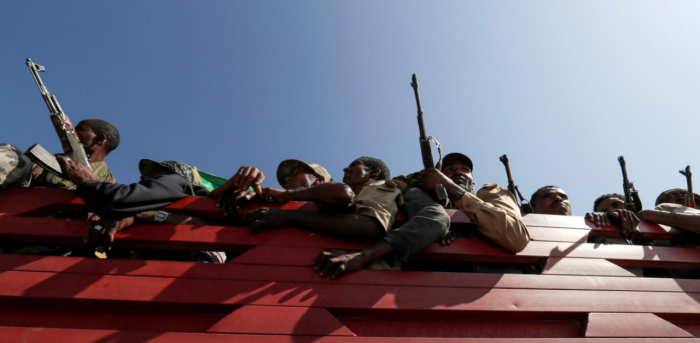 Militia members from Ethiopia's Amhara region ride on their truck as they head to face the Tigray People's Liberation Front (TPLF), in Sanja, Amhara. Credit: Reuters Photo