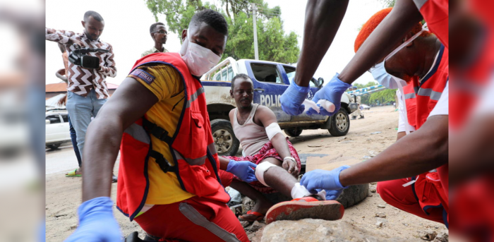 Paramedics attend to a man injured at the scene of a suicide explosion at a restaurant near a police academy, in Mogadishu, Somalia November 17, 2020. Credit: Reuters File Photo