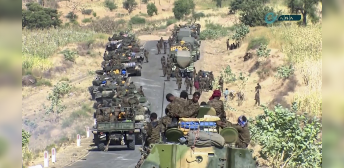 This image made from undated video released by the state-owned Ethiopian News Agency on Monday, Nov. 16, 2020 shows Ethiopian military gathered on a road in an area near the border of the Tigray and Amhara regions of Ethiopia. Credit: AP Photo