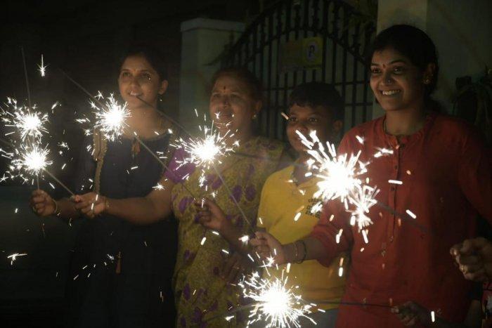 Residents of Mysuru light firecrackers on Sunday, as part of Deepavali.