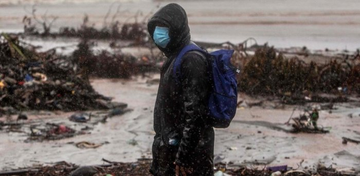 A man walsk at the beach in El Muelle neighbourhood in Bilwi, Puerto Cabezas, Nicaragua, on November 16, 2020 as Hurricane Iota -- upgraded to Category 5 -- moves over the Caribbean towards the Nicaragua-Honduras border. Credit: AFP.