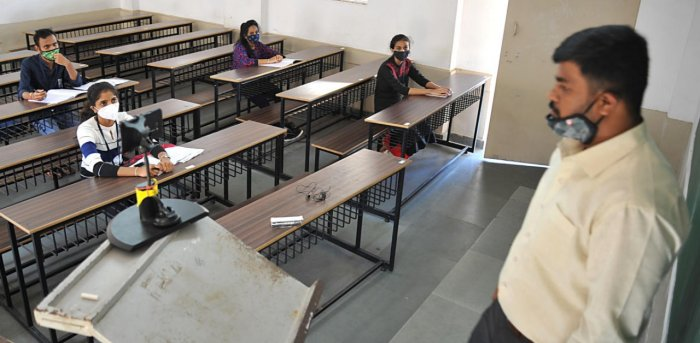 Students attend classes at Seshadripuram Degree College in Bengaluru on Tuesday as physical classes resume for the first time after Covid-19 lockdown. Credit: DH photo/Pushkar V.