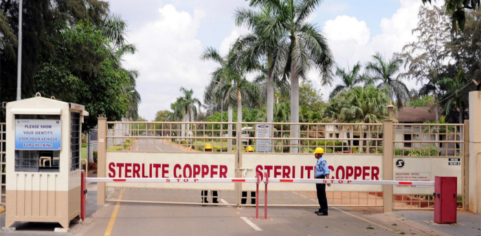 A private security guard stands in front of the main gate of Sterlite Industries Ltd's copper plant in Tuticorin. Credit: Reuters file photo.