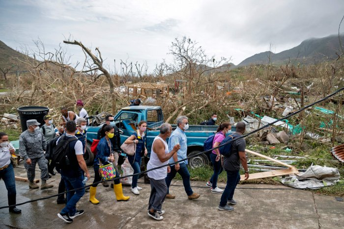 Handout photo released by the Colombian Presidency of Colombian President Ivan Duque (3-R) visiting areas damaged by Hurricane Iota in Providencia, Colombia, on November 17, 2020. - Iota left one person dead after sweeping the Colombian Caribbean island of Providencia, where it caused widespread damage. Credit: Colombian Presidency / AFP