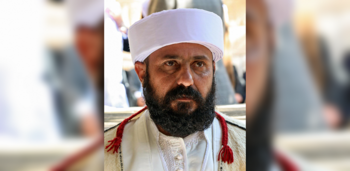 Baba Sheikh Ali Alyas, the new supreme spiritual leader of the Yazidi religious minority, attends his inauguration ceremony at the Lalish temple situated in a valley near Dohuk, 430 kilometres (260 miles) northwest of the Iraqi, capital on November 18, 2020. Credit: AFP Photo