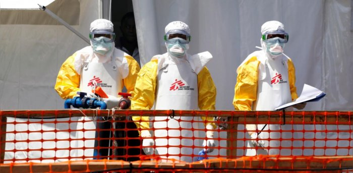 Health workers dressed in protective suits are seen at the newly constructed MSF(Doctors Without Borders) Ebola treatment centre in Goma, Democratic Republic of Congo. Credit: Reuters Photo