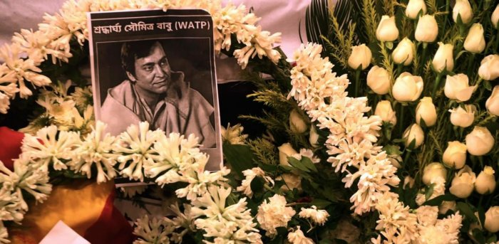 Soumitra Chatterjee's picture is seen on garlands. Credit: AFP Photo