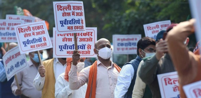 Bharatiya Janata Party (BJP) workers stage a protest against the ban on Chhath Pooja events, outside the residence of Delhi Chief Minister Arvind Kejriwal in New Delhi. Credit: PTI Photo