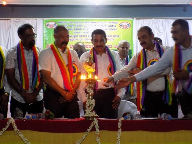 DCC Bank Chairman Kodandera Bond Ganapathy inaugurates the 67th All India Cooperative Week and centenary celebrations of Kunjila cooperative warehouse near Napoklu.