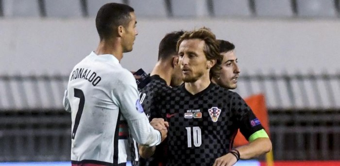 Portugal's midfielder Cristiano Ronaldo (L) greets Croatia's midfielder Luka Modric at the end of the UEFA Nations League A Group 3 football match between Croatia and Portugal. Credit: AFP Photo